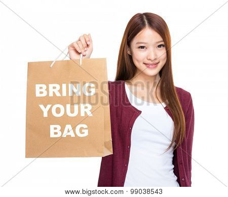 Woman hold with shopping bag and showing bring your bag