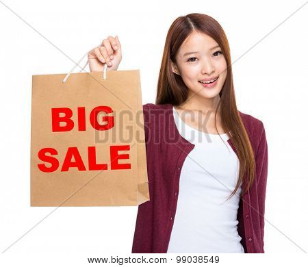 Asian woman take shopping bag and showing big sale