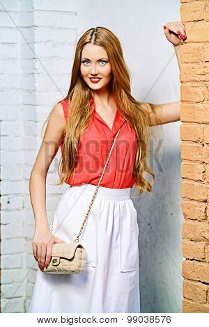 Beautiful young woman walking in the city. Beauty, fashion.