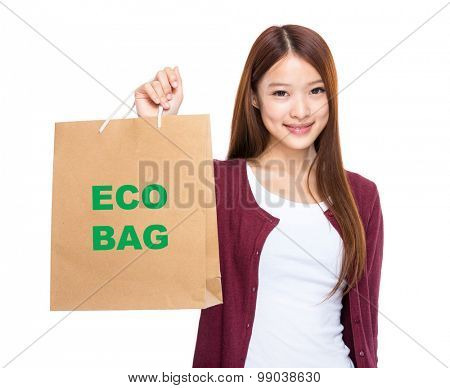 Woman hold with shopping bag and showing eco bag