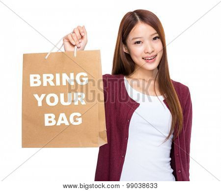 Asian woman take shopping bag and showing bring your bag