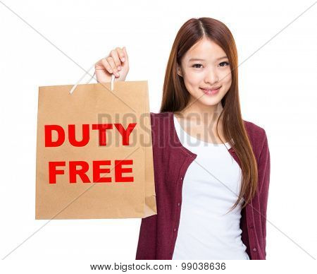 Woman hold with shopping bag and showing duty free