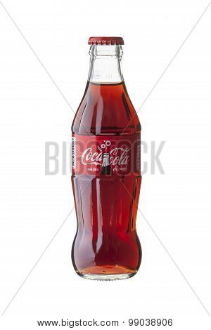 BANGKOK THAILAND - JULY 28 2015. Glass Bottle of Coca-Cola on white background. Logo for Celebrating Coca-Cola 100 years. Coca-Cola is produced by The Coca-Cola Company.