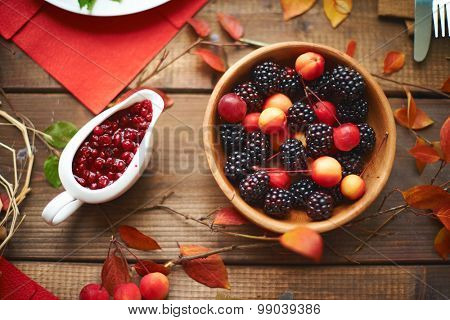Table with bowl of blackberry and cranberry preserve