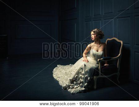 Woman in a white dress in studio