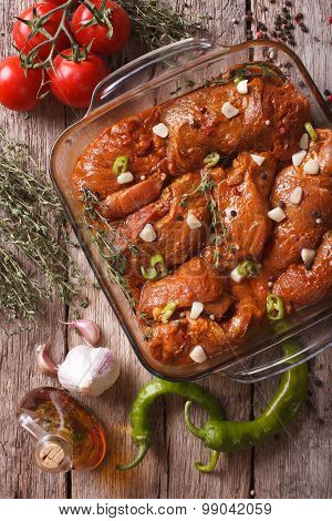 Meat In Red Marinade With Spices Close Up In A Bowl. Vertical Top View