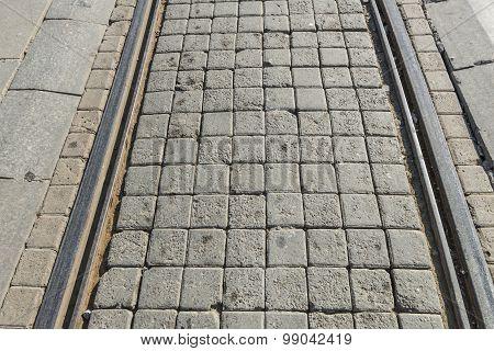Tram rails lined square stone stones