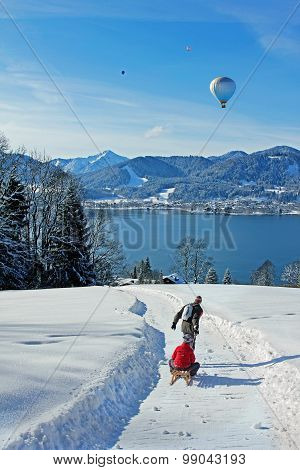 Father And Son At A Tobogganing Route In The Bavarian Alps