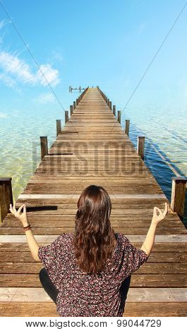 Woman Meditating On Boardwalk
