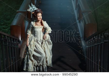 Girl In A Ball Gown On The Steps.