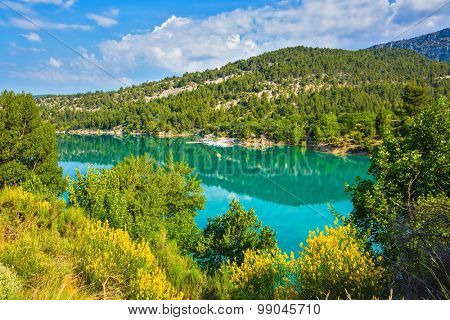 The biggest mountain canyon in the French Alps - Verdon. Spring Provence. Azure water reflects the clouds