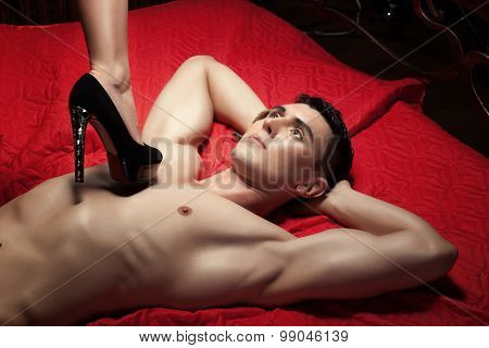 Guy On The Chest Is Female Foot In Shoe Heel.