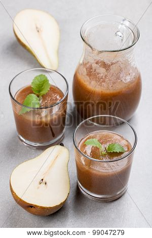 Two Glasses Of Pear Juices, Glass Pitcher And Ripe Pear