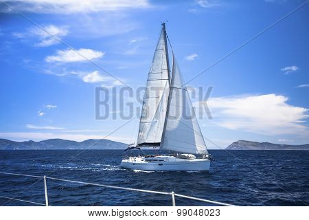 Sailing. Ship yachts with white sails in the Sea. Luxury boats.
