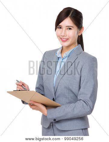 Asian Businesswoman write on file board