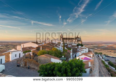 Europe, Portugal, Alentejo-Panoramic view of the small village of Monsaraz at sunset near