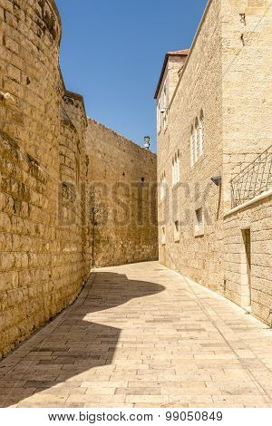 narrow streets of old Jerusalem. Stone houses and arches