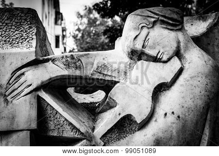 Stone Statue Playing Violin In Black And White