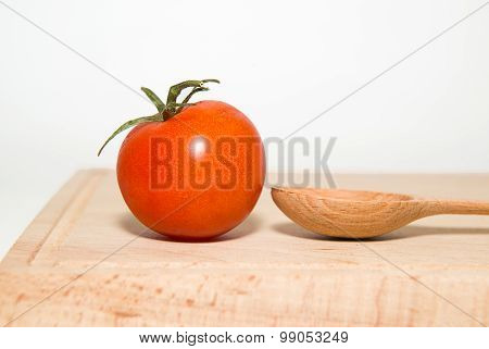 Red Ripe Tomatoes On A White Background