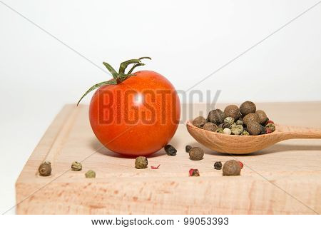 Red Tomatoes, Spoon, Pepper On A White Background
