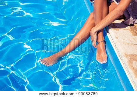 Closeup portrait of female legs in swimming pool
