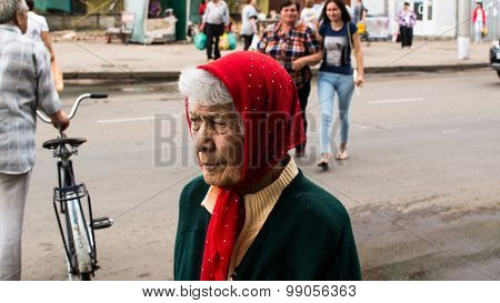 Elderly Woman In A Red Scarf