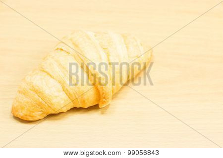Croissant On A Wooden