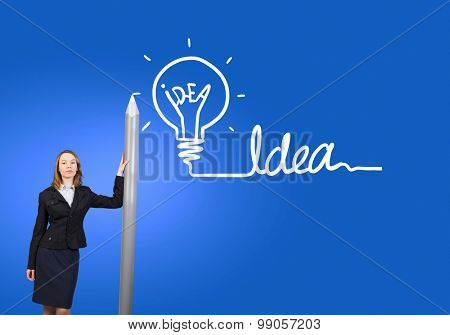 Businesswoman  drawing word idea with huge pencil