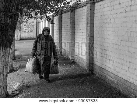 Elderly Woman Pensioner With Shopping Bags