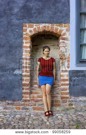 Young Woman In A Brick Arc