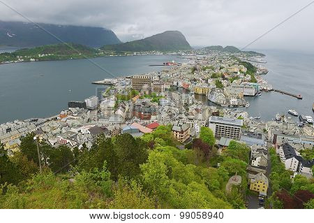 Wide angle wiew to the Alesund city on a cloudy summer day in Alesund, Norway.