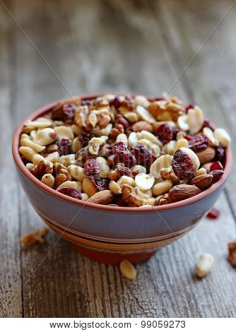 Mix Of Dried Fruits And Nuts In A Ceramic Bowl, Selective Focus