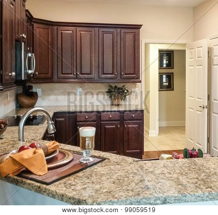 Kitchen With Dark Cabinets And Granite Counters