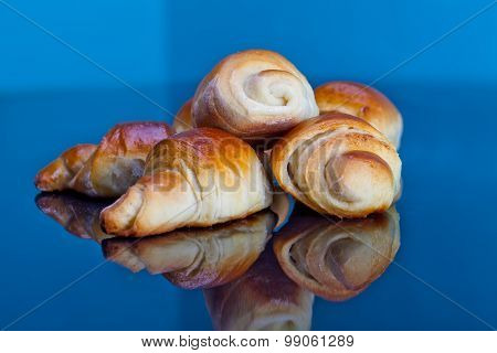 Freshly baked croissants on plate for breakfast