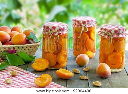 Fresh apricots and jar preserves