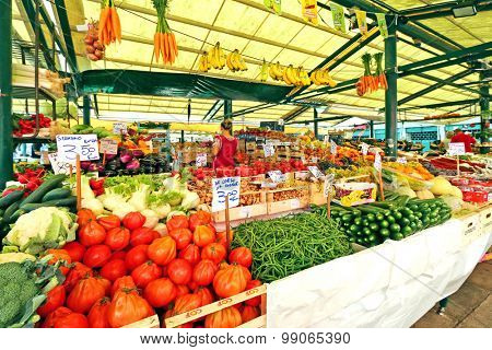 VENICE, ITALY - SEPTEMBER 2014: Different types of fresh fruit, vegetables for sale at the Rialto Italian market in Venice, Italy on September 15, 2014. The market's been operating more than 700 years