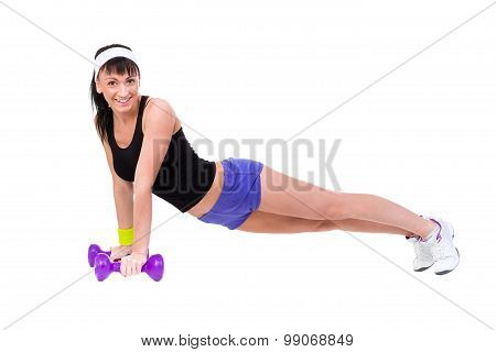 Healthy woman pushups with dumbbells working out