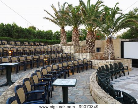 20.06.2015 CRETE, GREECE. Modern Amphitheater Plastic Chairs And Palm Trees