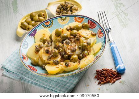 potatoes salad with green olives capers and hot chili pepper