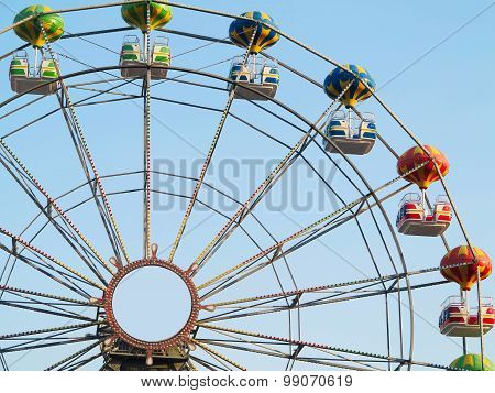 12.07.2015, BULGARIA, GOLDEN SANDS. Brightly Colored Ferris Wheel Against The Blue Sky