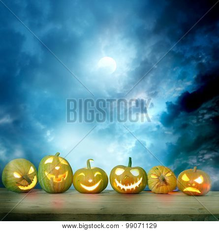 Spooky halloween pumpkins on a wooden table
