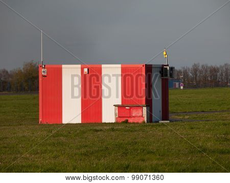 Small red-white booth on the airport