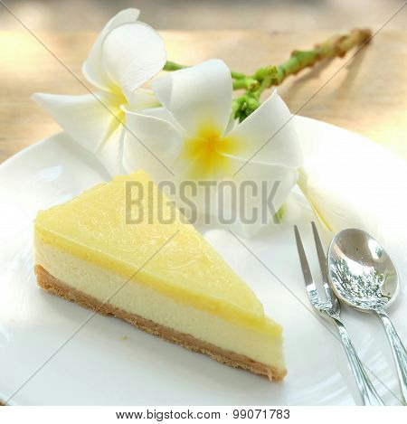 Lemon Cheese Pie Decorated With Flowers On A White Porcelain Plate