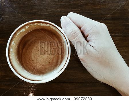Sipping A Cup Of Coffee Latte On Dark Wood Table