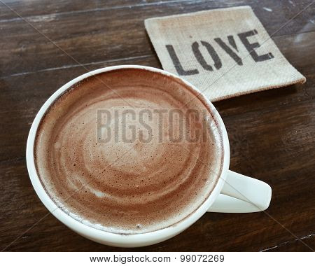 Coffee Latte On Dark Wood Table With The Word