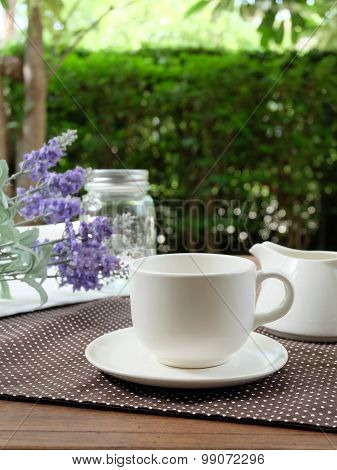 Relax With A White Cup Of Coffee In The Green Garden