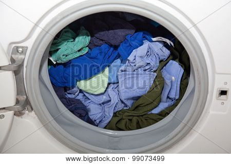 Blue Laundry In Washing Machine