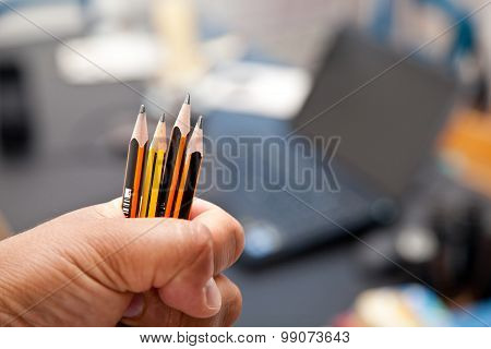 Hand With Pencil At Home Office