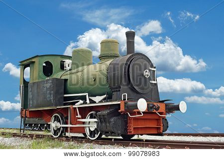 Old Steam Engine Locomotive Train On Beautiful Sky Background