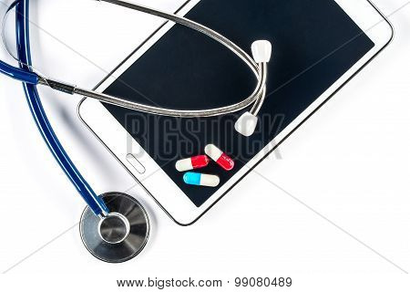 Pills And Stethoscope With Tablet, Capsule On Touch Screen